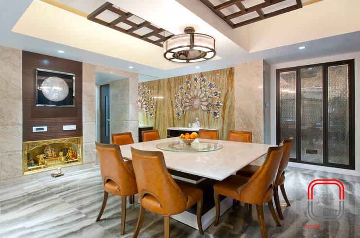 Juhu Residence:  Dining room by neale castelino Photography
