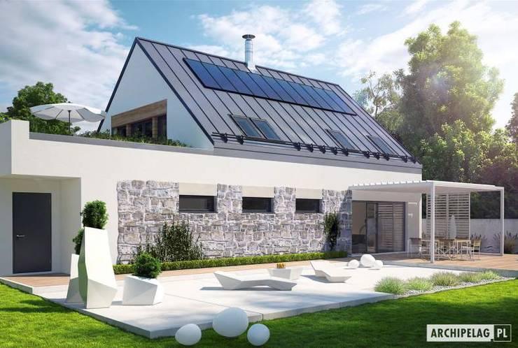 Sam II G2 ENERGO PLUS – nowoczesny dom z otwartą strefą dzienną i dwoma tarasami : styl , w kategorii Dom jednorodzinny zaprojektowany przez Pracownia Projektowa ARCHIPELAG
