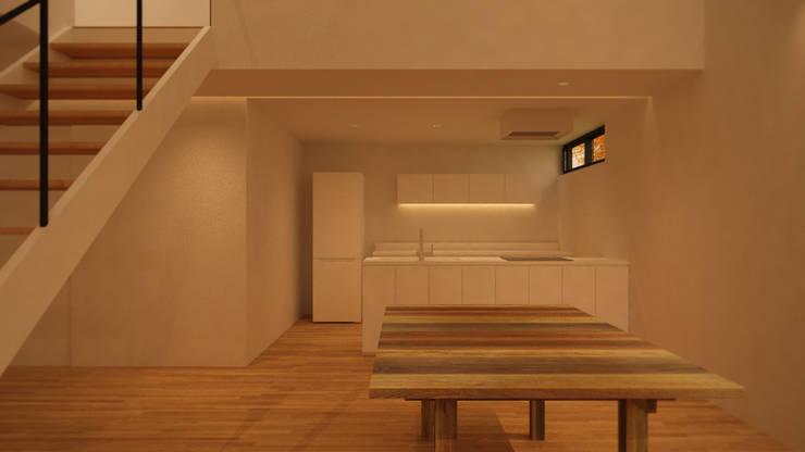 1층에 위치한 리빙룸과 다이닝테이블: ARA의  주방