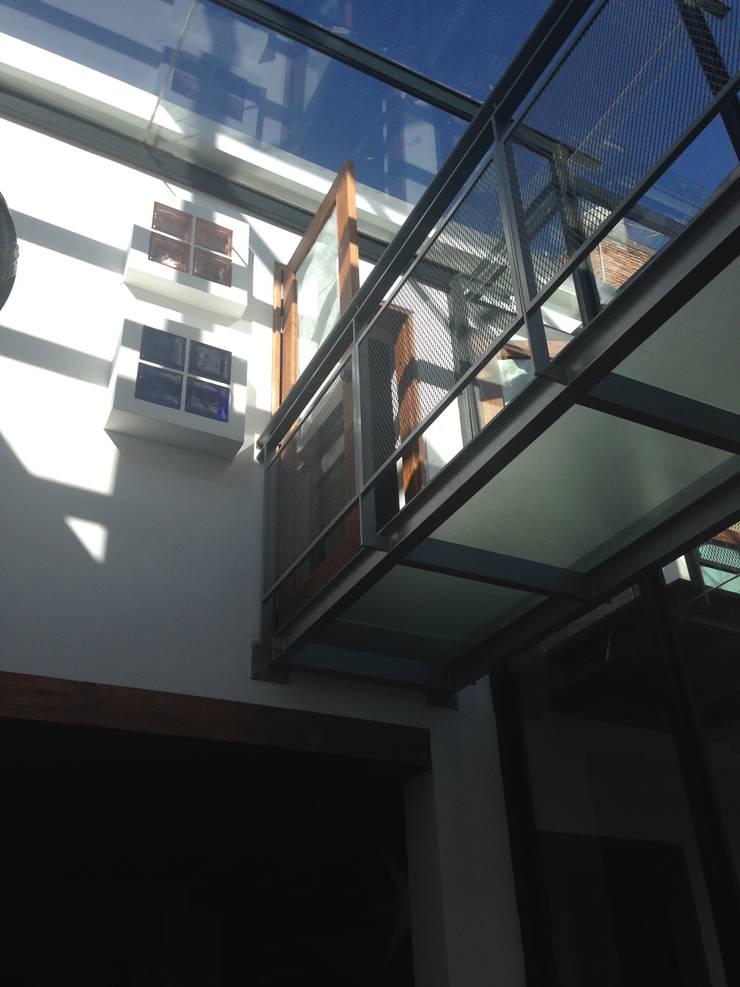 CASA BARBATUSCOS:  de estilo  por Terra Arquitectura