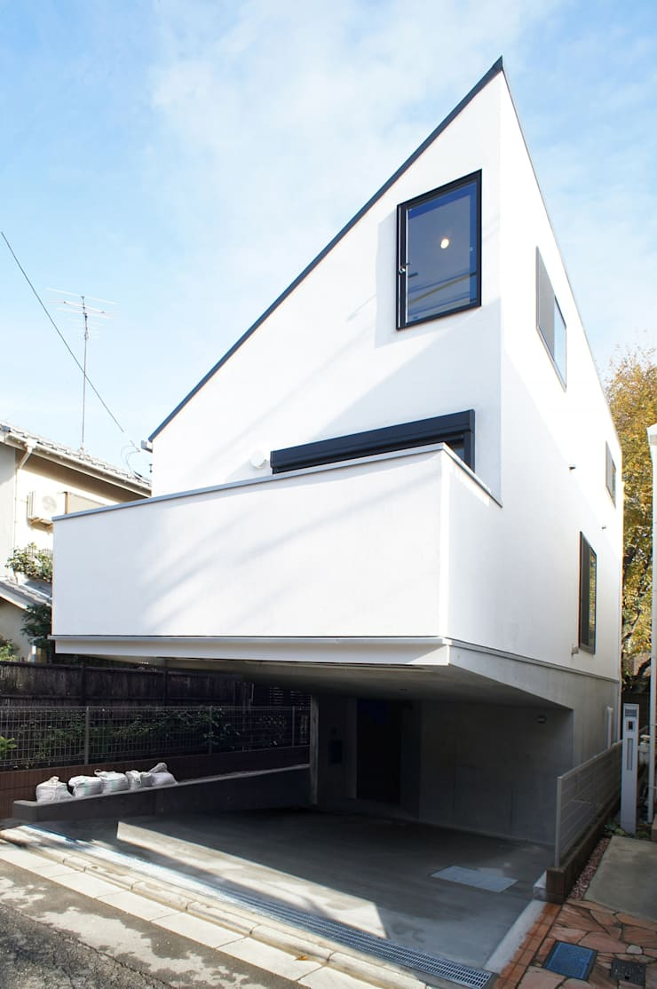 Maison individuelle de style  par 一級建築士事務所A-SA工房,