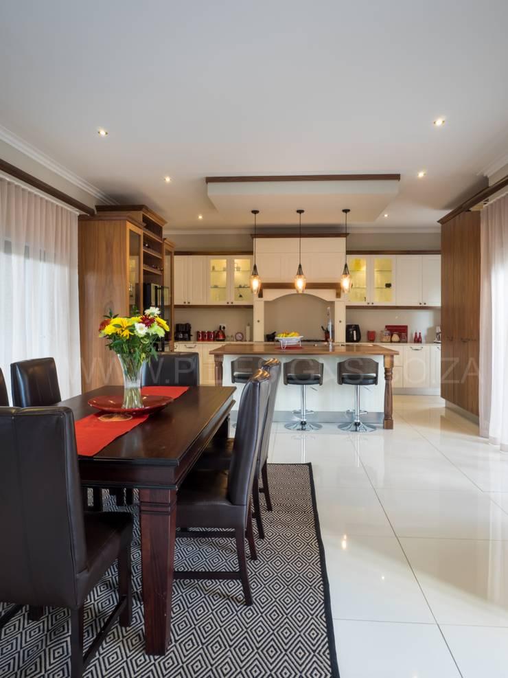 HOUSE DLAMINI:  Kitchen units by Première Interior Designs