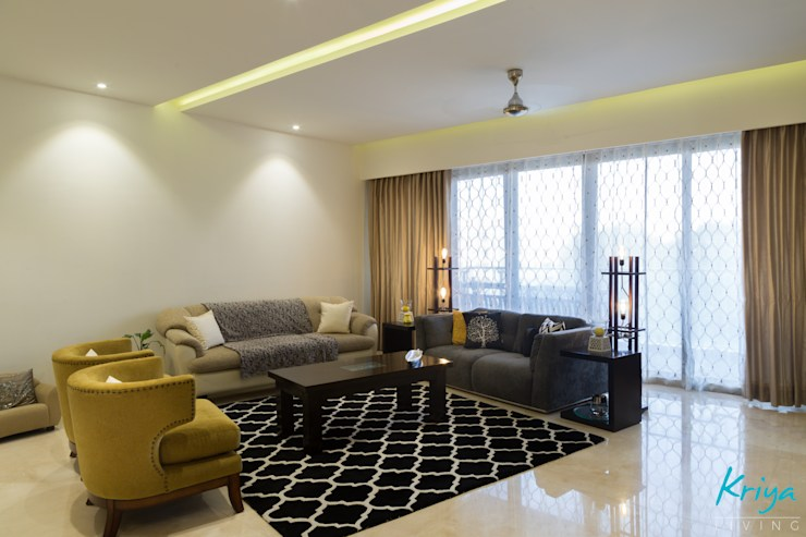 3 BHK Apartment - Raheja Pebble Bay:  Living room by KRIYA LIVING