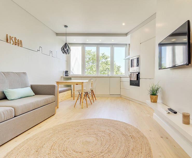 Apartamento da Alegria: Salas de estar  por Homestories