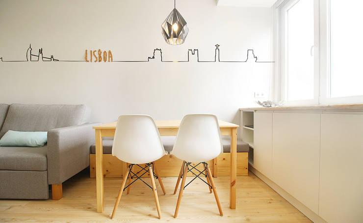 Apartamento da Alegria: Salas de jantar  por Homestories