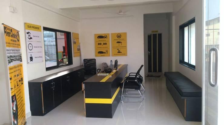 Design, Build & Interiors for a Car Dealer:  Office buildings by QUADRA DESIGNS INTERIOR DESIGNERS & ARCHITECTS