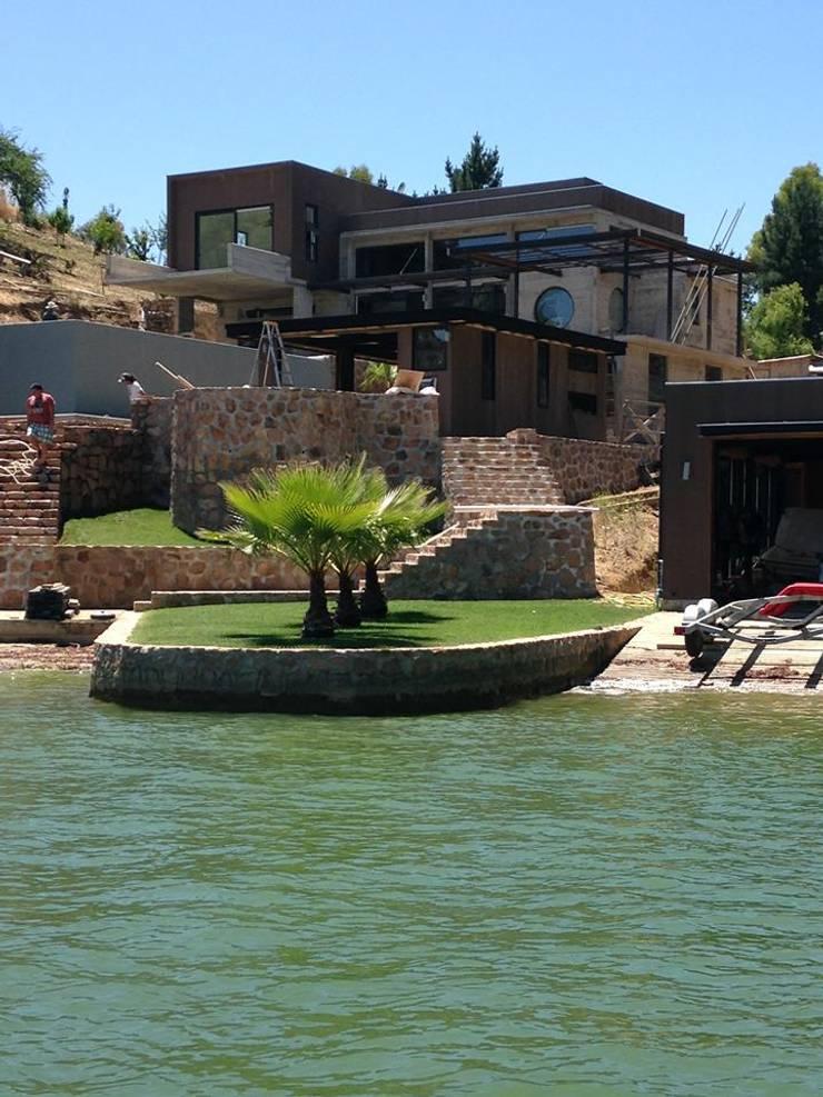 Casa EFZ 01: Casas unifamiliares de estilo  por Sotomayor & Asociados
