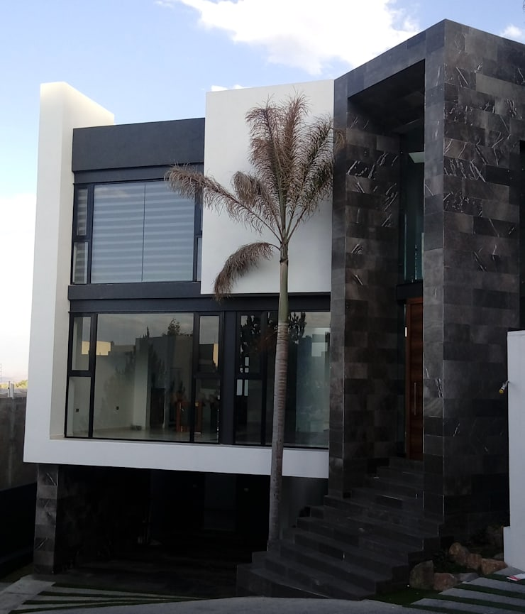 Fachada Principal: Casas unifamiliares de estilo  por GRUPO VOLTA, Moderno Mármol