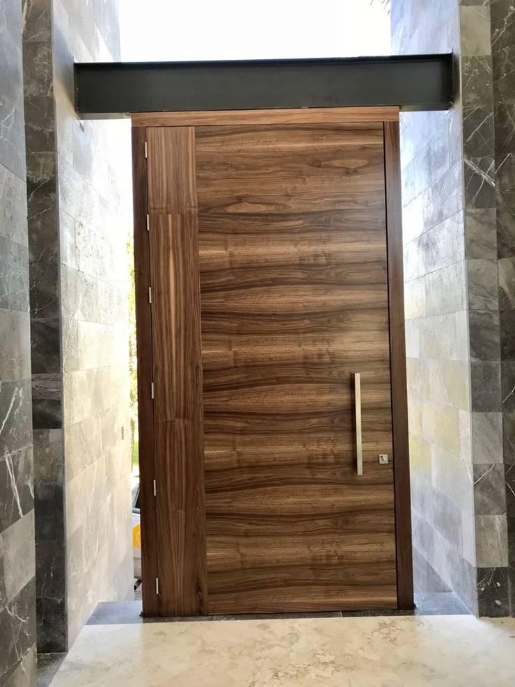 โดย GRUPO VOLTA โมเดิร์น ไม้ Wood effect