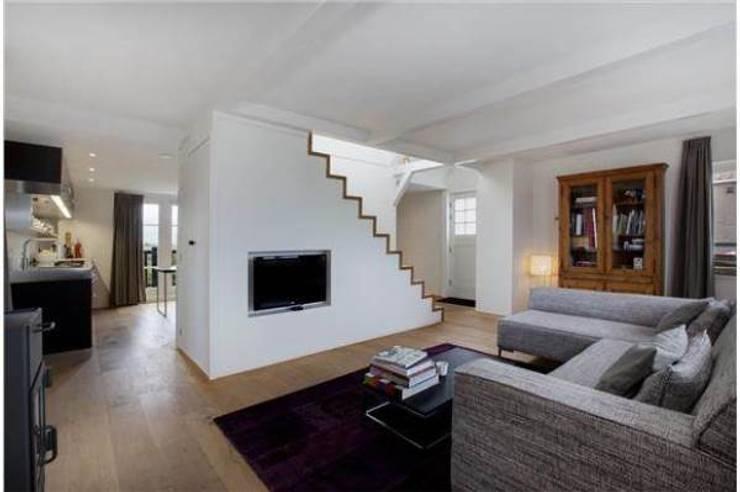 Salon de style  par Dineke Dijk Architecten