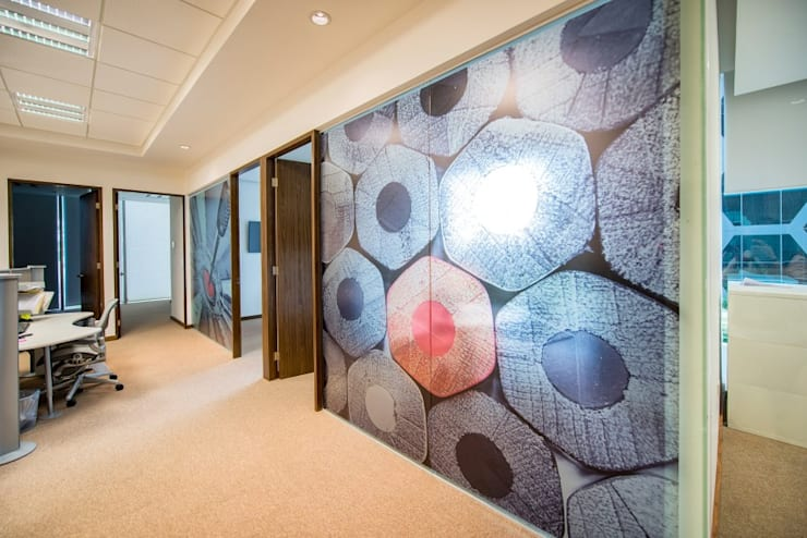 Xentia: Oficinas y tiendas de estilo  por ESTUDIO TANGUMA