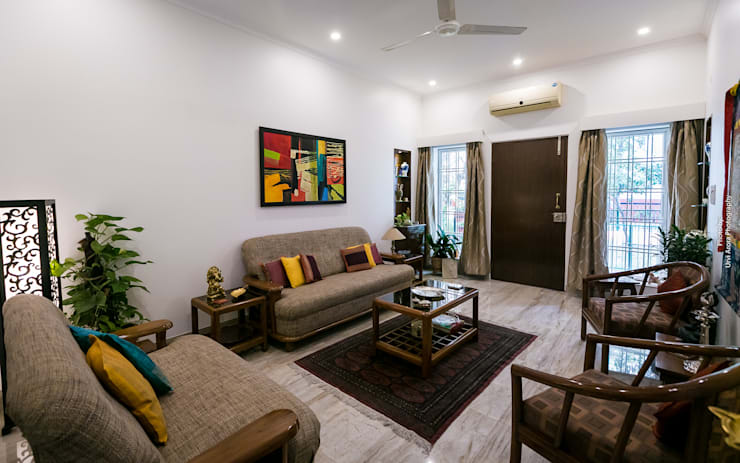 Home Renovation:  Living room by Rennovate Home Solutions pvt ltd
