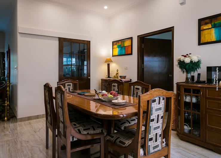 Home Renovation:  Dining room by Rennovate Home Solutions pvt ltd