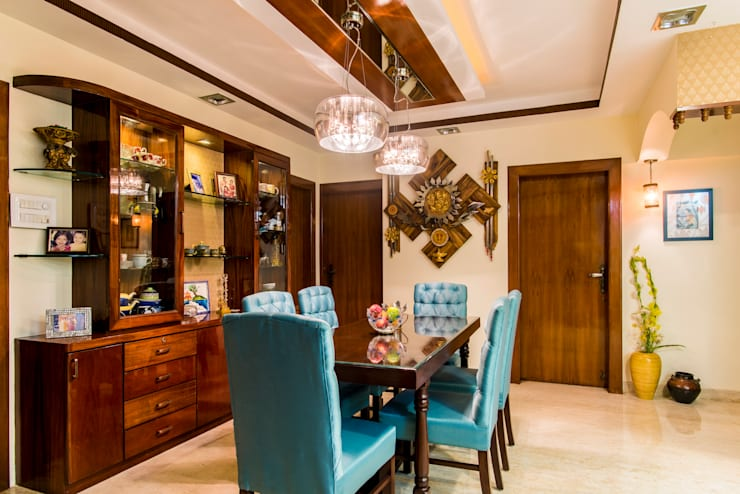 Chembur Renovation:  Dining room by Rennovate Home Solutions pvt ltd
