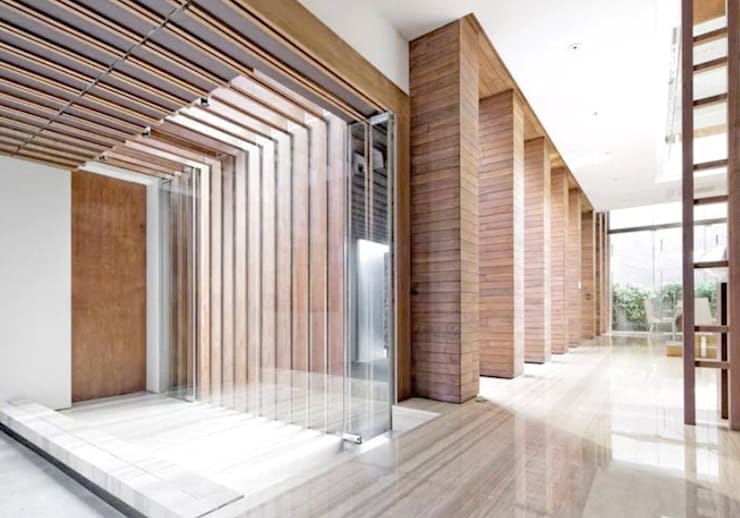Patal Senayan Residence:  Koridor dan lorong by Jati and Teak