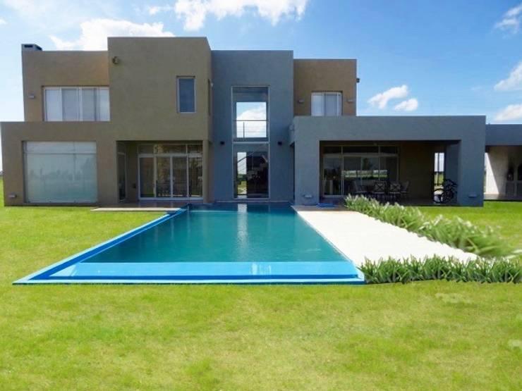 Casa minimalista en San Vicente de Estudio Dillon Terzaghi Arquitectura - Pilar Minimalista Ladrillos
