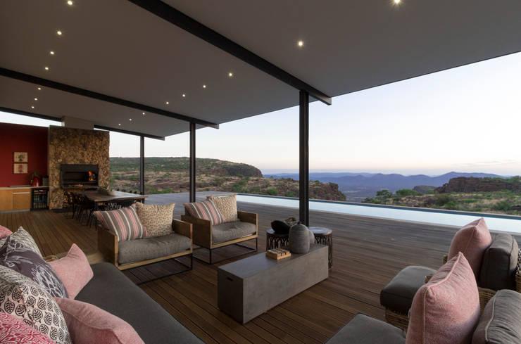 Entertainment area :  Patios by Hugo Hamity Architects , Modern