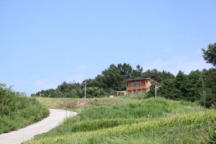 Chalets & maisons en bois de style  par 北村建築設計事務所, Moderne