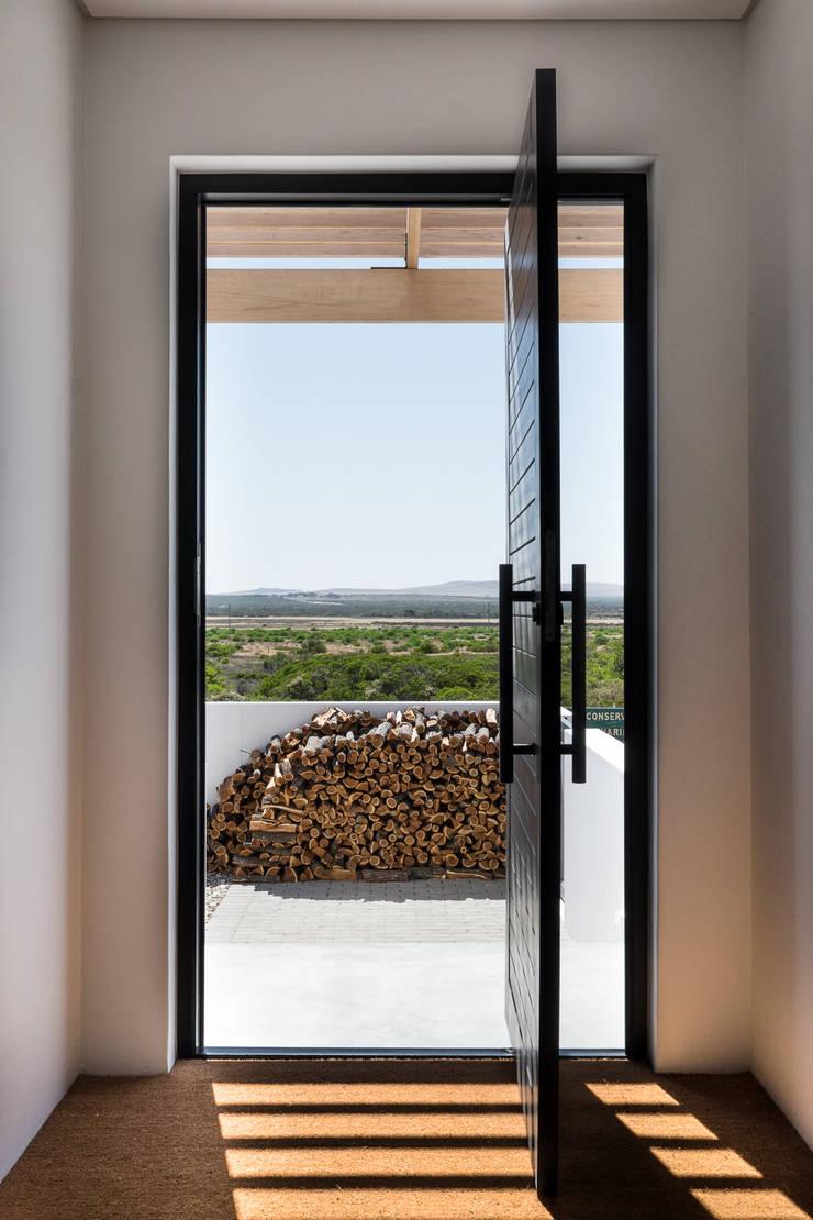 Project: Volstruis Ave, Yzerfontein:  Front doors by de Beyer Design Studio