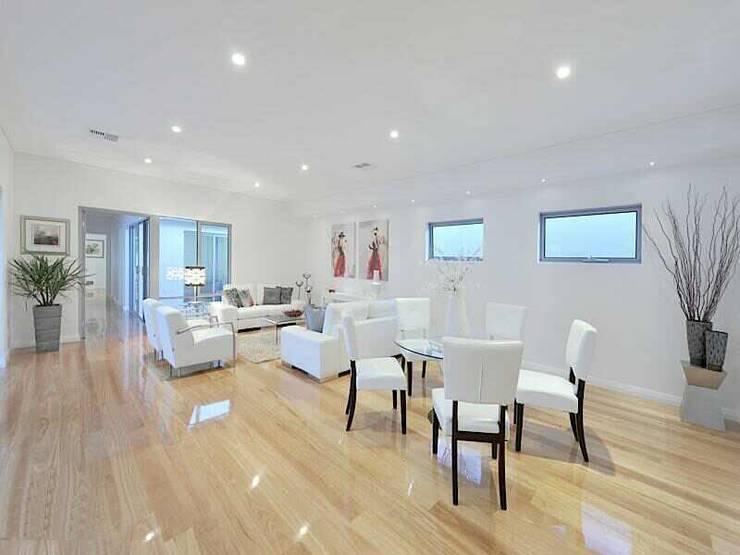 Wembley units:  Living room by Marzia Design