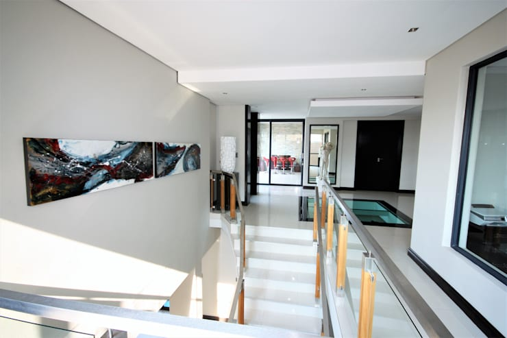 looking at foyer from stairs:  Stairs by Nuclei Lifestyle Design