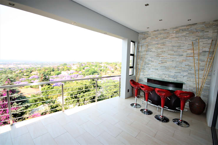 Patio next to the DVD room:  Patios by Nuclei Lifestyle Design