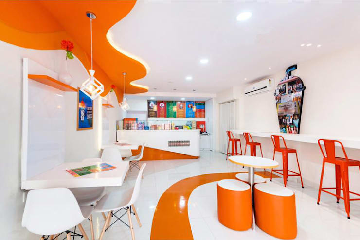 A very vibrant colour theme cafe interiors :  Gastronomy by Rhythm  And Emphasis Design Studio ,Modern