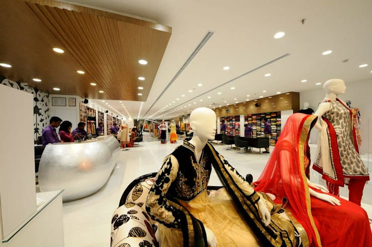 Boutique retail store design in modern style :  Offices & stores by Rhythm  And Emphasis Design Studio ,Modern
