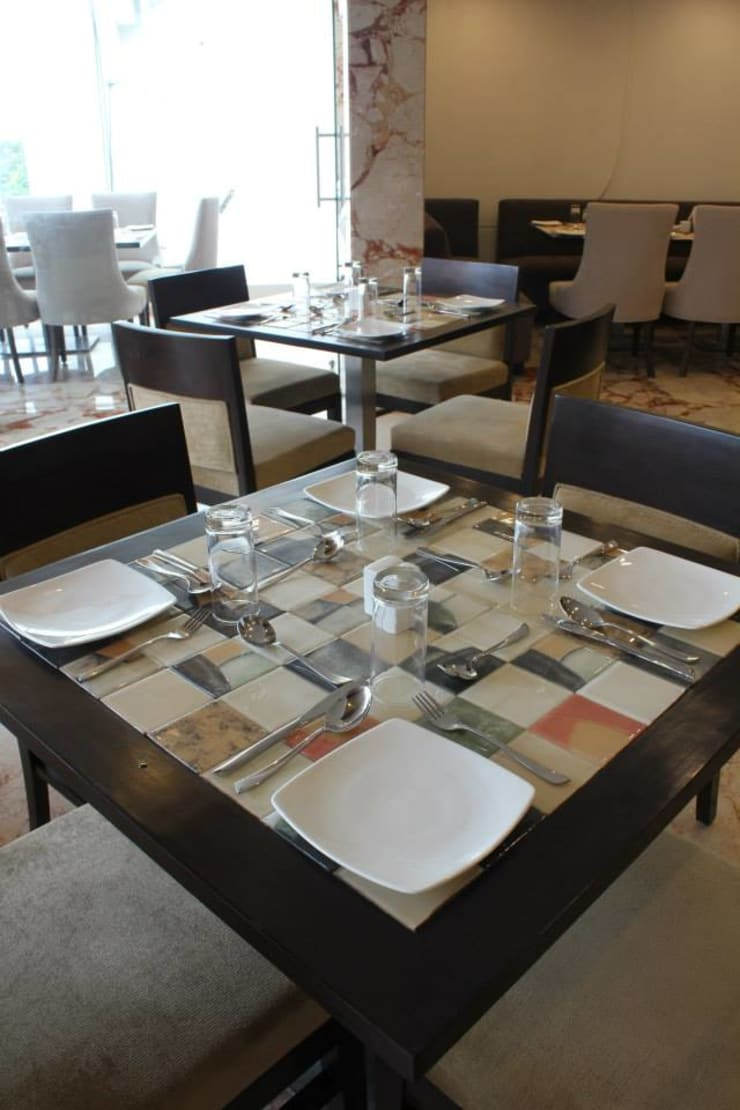 dining table design in the restaurant :  Gastronomy by Rhythm  And Emphasis Design Studio ,Modern