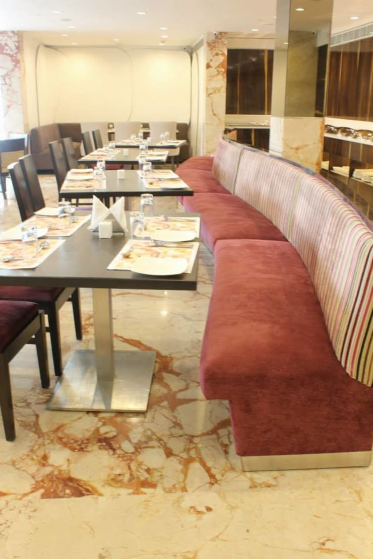 Sofa with chair seating in the dining hall :  Gastronomy by Rhythm  And Emphasis Design Studio ,Modern