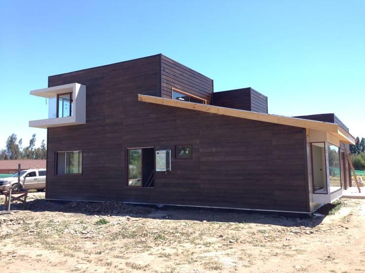Construcción de Casa Munchmeyer Rumpf por Arqbau: Casas unifamiliares de estilo  por Arqbau Ltda.