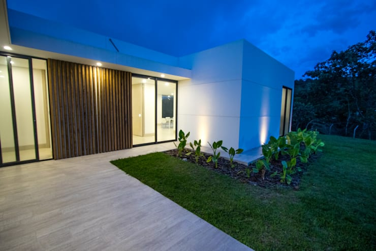 Casa de campo / lopez : Casas de estilo  por astratto