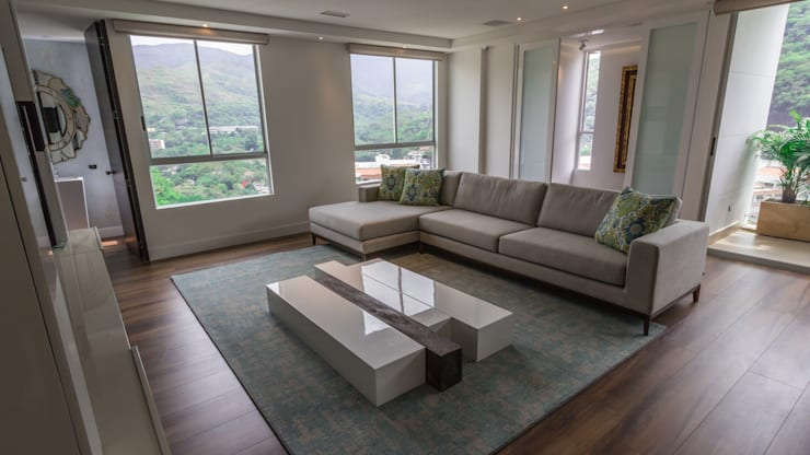 Apartamento bosques del oeste : Salas de estilo  por astratto