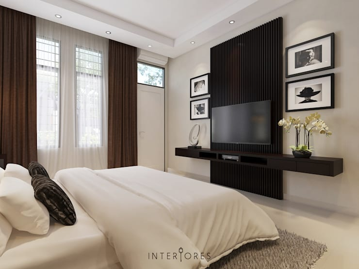 Wall-unit TV:   by INTERIORES - Interior Consultant & Build