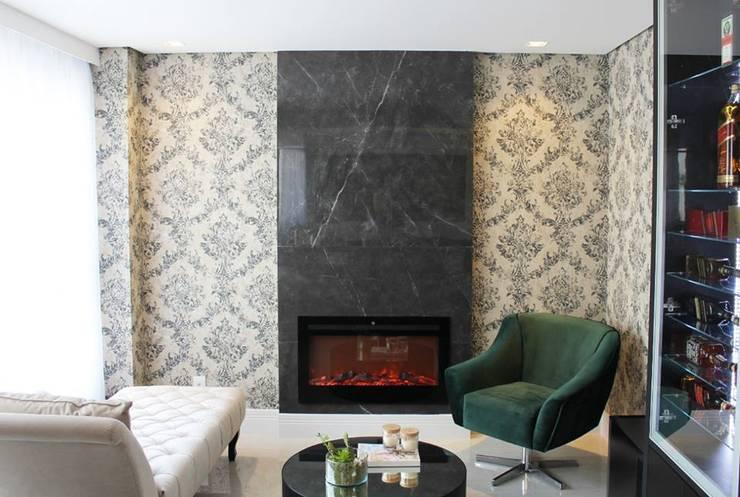 Apartamento 09: Salas de estar  por P.B Arquitetura