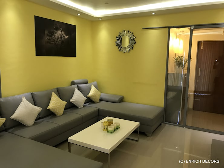 Living Room and Foyr Area:  Living room by Enrich Interiors & Decors,Modern