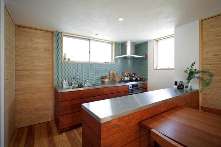 木とステンレスのオリジナルキッチン: kisetsuが手掛けたキッチンです。