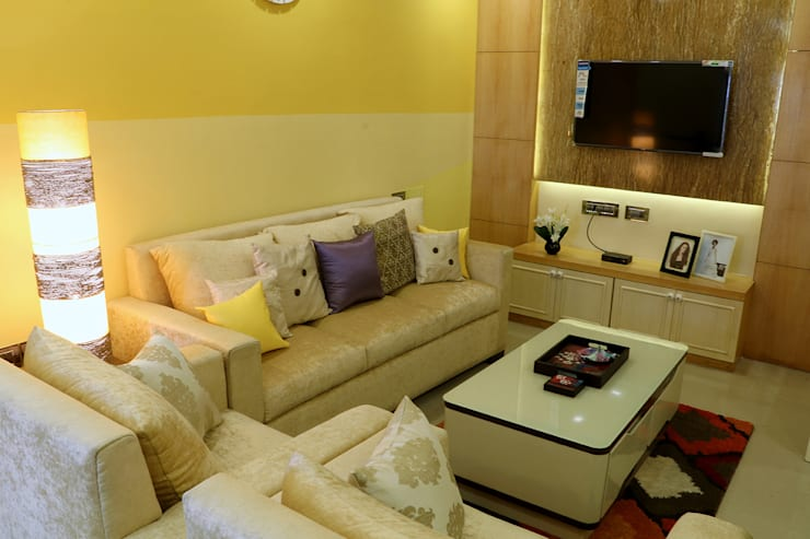 2 BHK Apartment of Mr Alex Parera Kolkata:  Living room by Cee Bee Design Studio,Modern