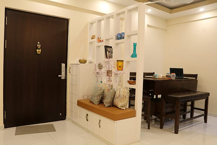 2 BHK Apartment of Mr Santosh Nambiath Bangalore:  Living room by Cee Bee Design Studio