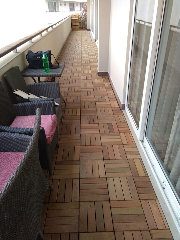 IPE Deckwood Tiles:  Single family home by Opulo India,Country Wood Wood effect