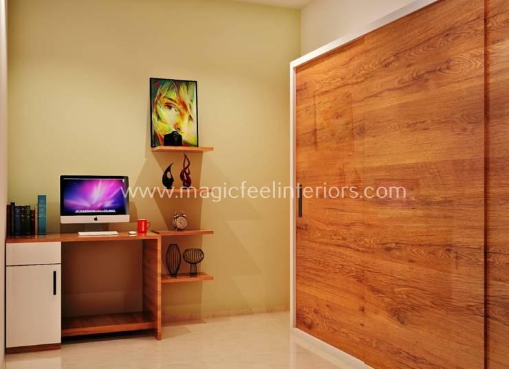 Guest Bedroom & Study Room:  Bedroom by Magic Feel Interiors,Modern