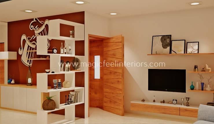 Living Room:  Living room by Magic Feel Interiors,Modern