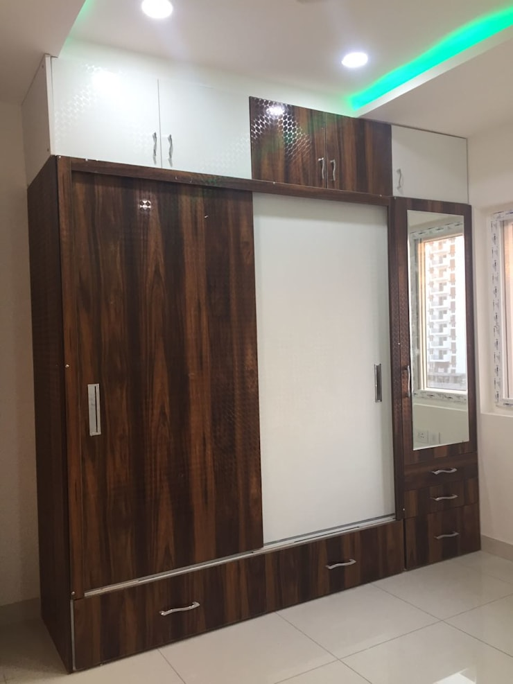 Project 2:  Dressing room by Meticular Interiors LLP,Modern