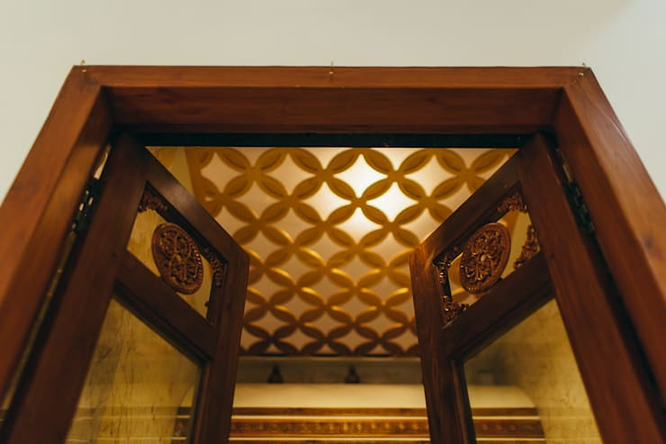 Pooja Ceiling:  Living room by Geometrixs Architects & Engineers