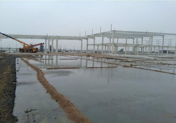 INDUSTRIAL RUNNING WORK AT SANAND:  Flat roof by Monoceros Interarch Solutions,Industrial Iron/Steel