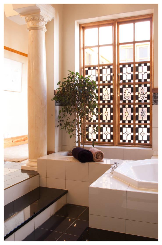 newly built en-suite:  Bathroom by Nuclei Lifestyle Design