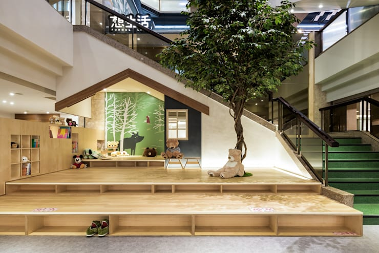 公共閱讀空間也能夠像家一樣舒適 - 高雄福華飯店 「想生活」:  活動場地 by 青易國際設計