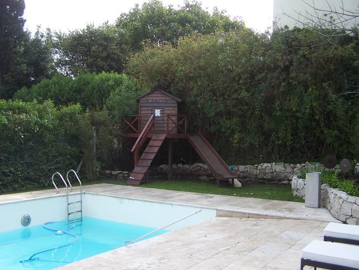ANTES: Jardines de estilo  por Vivero Antoniucci S.A.