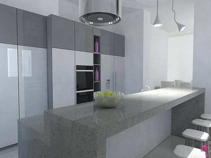 Cucina con isola centrale von CASE IN PUNTA DI MOUSE di ...