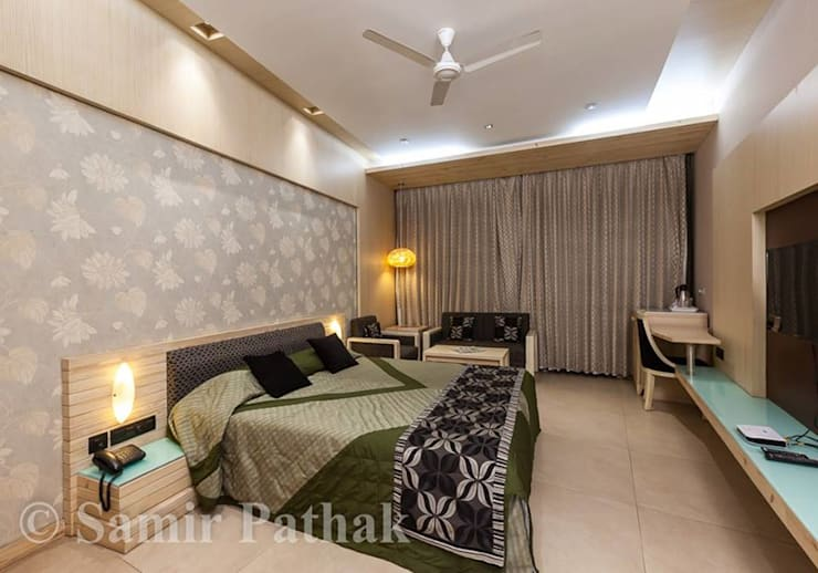 BEDROOM  and LIVING ROOM INTERIORS : modern  by Monoceros Interarch Solutions,Modern Plywood